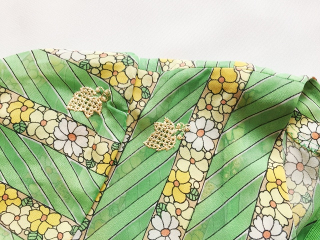 Sheer polyester fabric with embroidered leaves